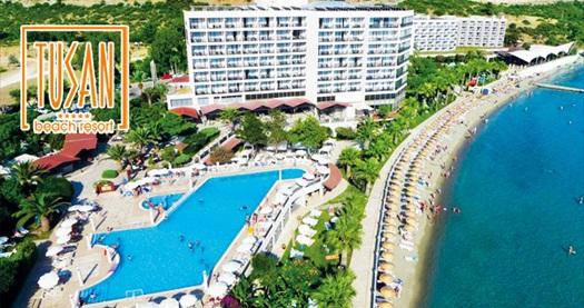 Kuşadası Tusan Beach Resort Hotel'de çift kişilik odalarda kişi başı HER ŞEY DAHİL 1 gece konaklama 100 TL'den başlayan fiyatlarla! Fırsatın geçerlilik tarihi için, DETAYLAR bölümünü inceleyiniz.