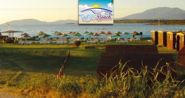 Çeşme Günizi Beach'de 2 veya 3 kişilik bungalov evlerde 1 gece konaklama, serpme kahvaltı, şezlong ve plaj girişi 160 TL'den başlayan fiyatlarla! Fırsatın geçerlilik tarihi için DETAYLAR bölümünü inceleyiniz.