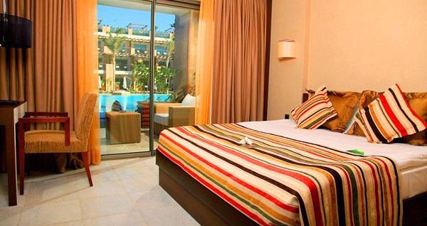 5 yıldızlı Girne Cratos Premium Hotel'de TAM PANSİYON PLUS uçaklı konaklama paketleri kişi başı 1.199 TL'den başlayan fiyatlarla! Detaylı bilgi ve size en uygun fiyatların sunulması için hemen 0850 532 50 76 numaralı telefonu arayın!