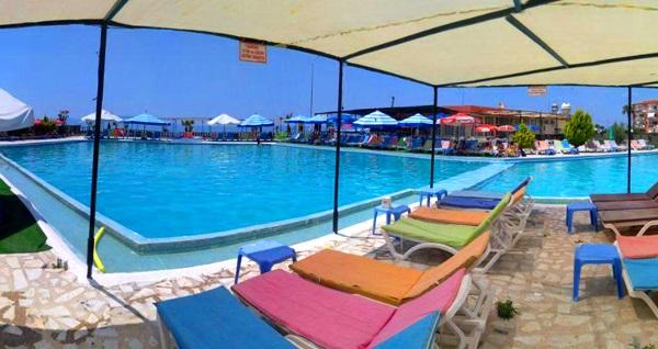 Kuşadası Rainbow Beach Club'ta serpme kahvaltı, havuz girişi ve plaj girişi kişi başı 63 TL yerine 34,90 TL! Fırsatın geçerlilik tarihi için DETAYLAR bölümünü inceleyiniz.